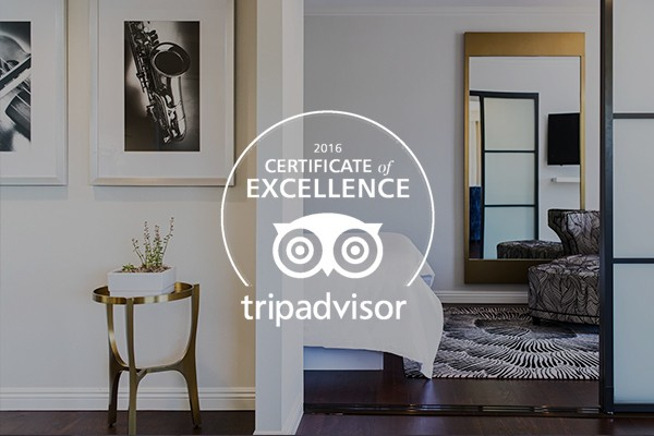 white tripadvisor logo with a interior view of bedroom in the background