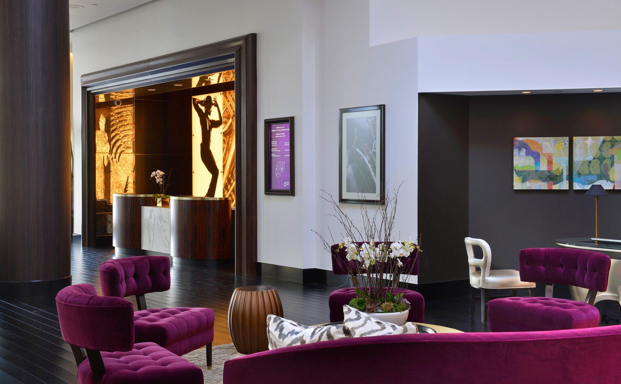 tufted purple sofa set on living room