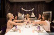 five women sitting beside table