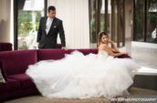groom and bride sitting on sofa