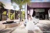 bride standing near silver sedan