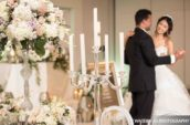 bride and groom near bouquet of flowers