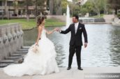 groom and bride smiling near body of water
