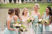 bride standing between bridesmaid's