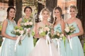 bride in white wedding dress and four bride's maids