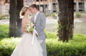 bride standing besde groom