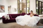 woman wearing white wedding gown sitting on purple couch
