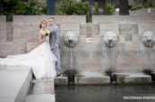 groom and bride standing near body of water during daytime