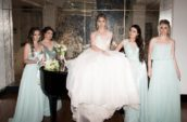 bride standing between four bridesmaids
