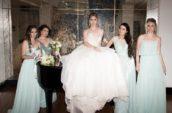 bride standing between four bridesmaids
