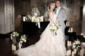 bride and groom near black table