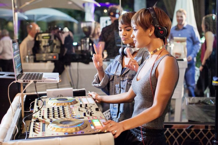 two women DJ-ing at a party
