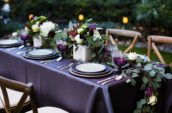 brown wooden chairs and purple table mats