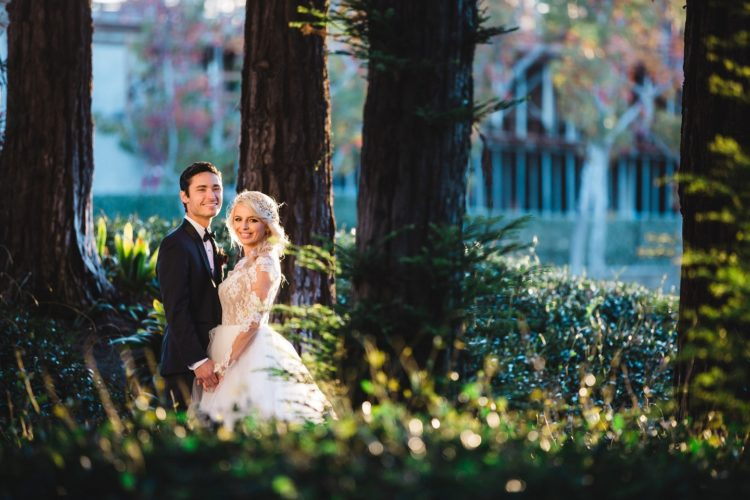 woman wearing wedding gown and man wearing black suit jacket