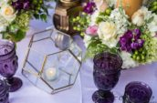 purple goblet glasses and assorted-colored flowers