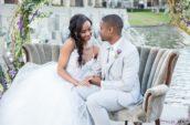 bride and groom sitting on grey sofa