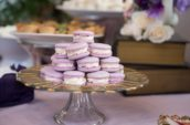 purple macaroons on glass pedestal rack