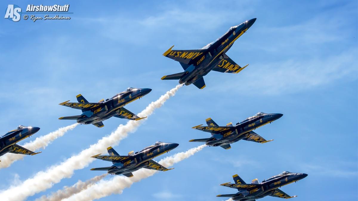 six blue fighter jets under blue sky