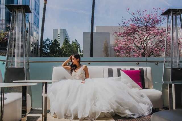 woman in white wedding gown sitting on white couch