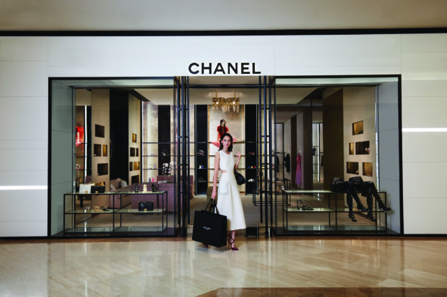 Woman in front of Chanel store