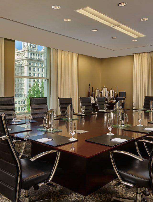 interior of Frank boardroom with fourteen chairs surrounding large table