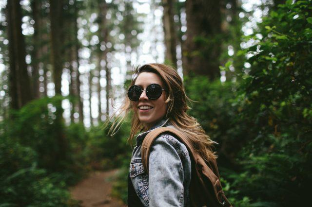 young woman enjoys a hike during her stay at the nines
