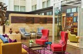 wing back chairs and glass partitions at a luxury hotel in portland