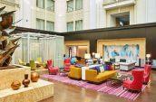 art filled the nines hotel atrium space