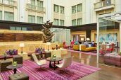 spacious and colorful atrium at the nines hotel in portland