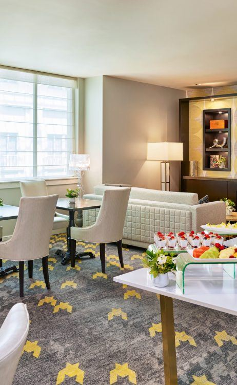 luxury hotel club room with buffet and fireplace