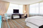 corner king bed guest room at the nines hotel portland