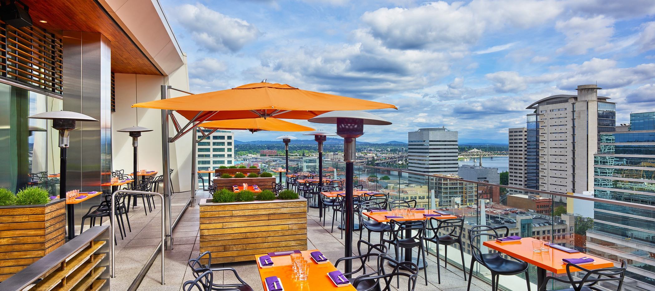 outdoor rooftop dining terrace at the nines hotel in portland