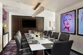 art fills the walls in this modern and technology equipped boardroom