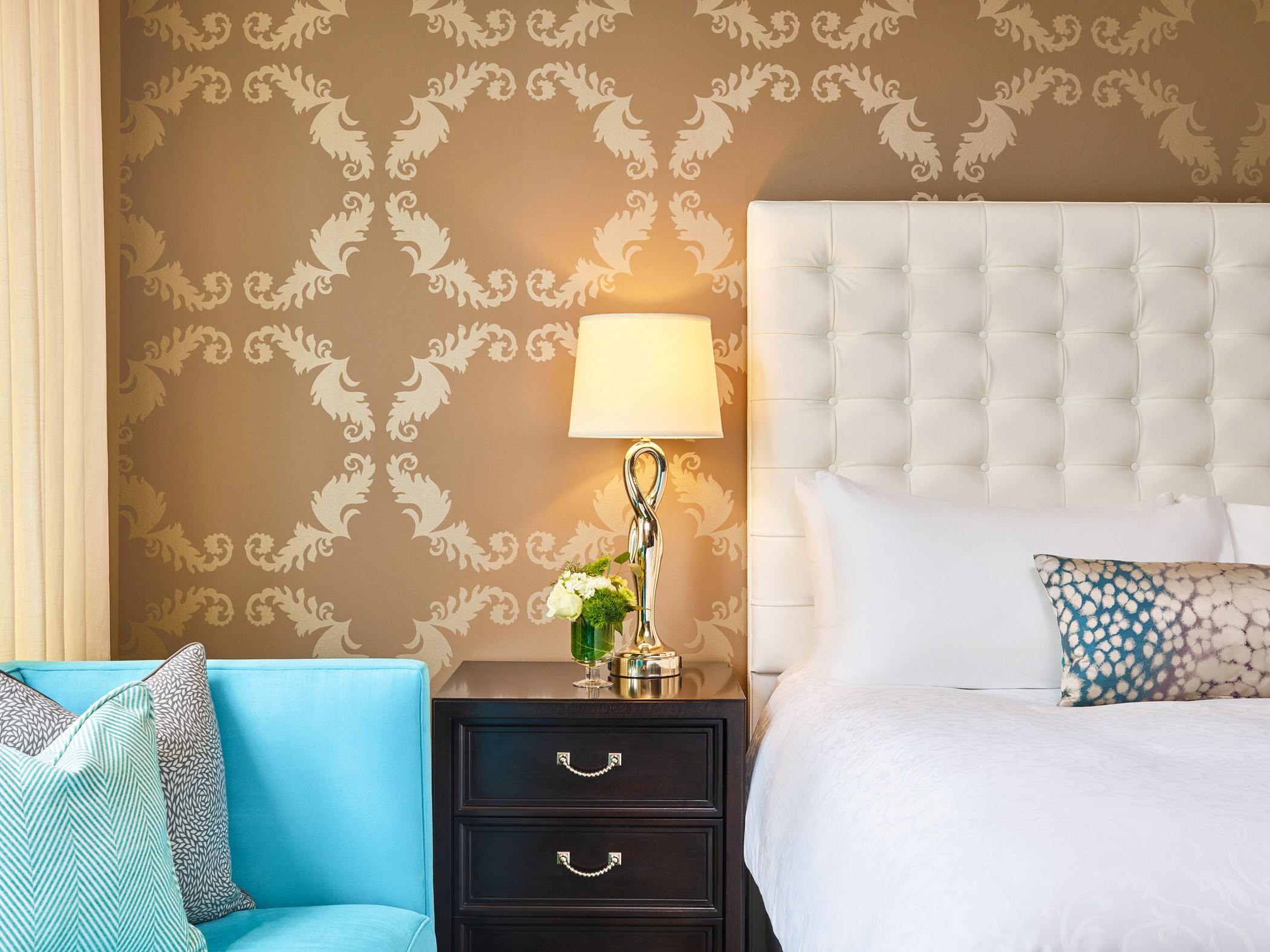 modern wallpaper and art inspired colours accent the nines hotel guest rooms
