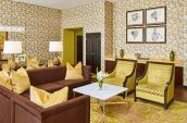 living and dining space in a luxury suite at the nines hotel