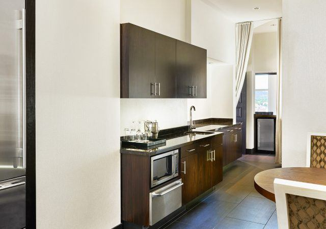 modern kitchen in a suite at the nines hotel portland