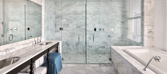 marble bathroom with lots of natural light at the nines hotel