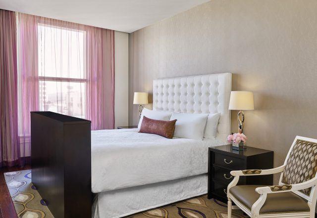 the nines hotel suite guest bedroom