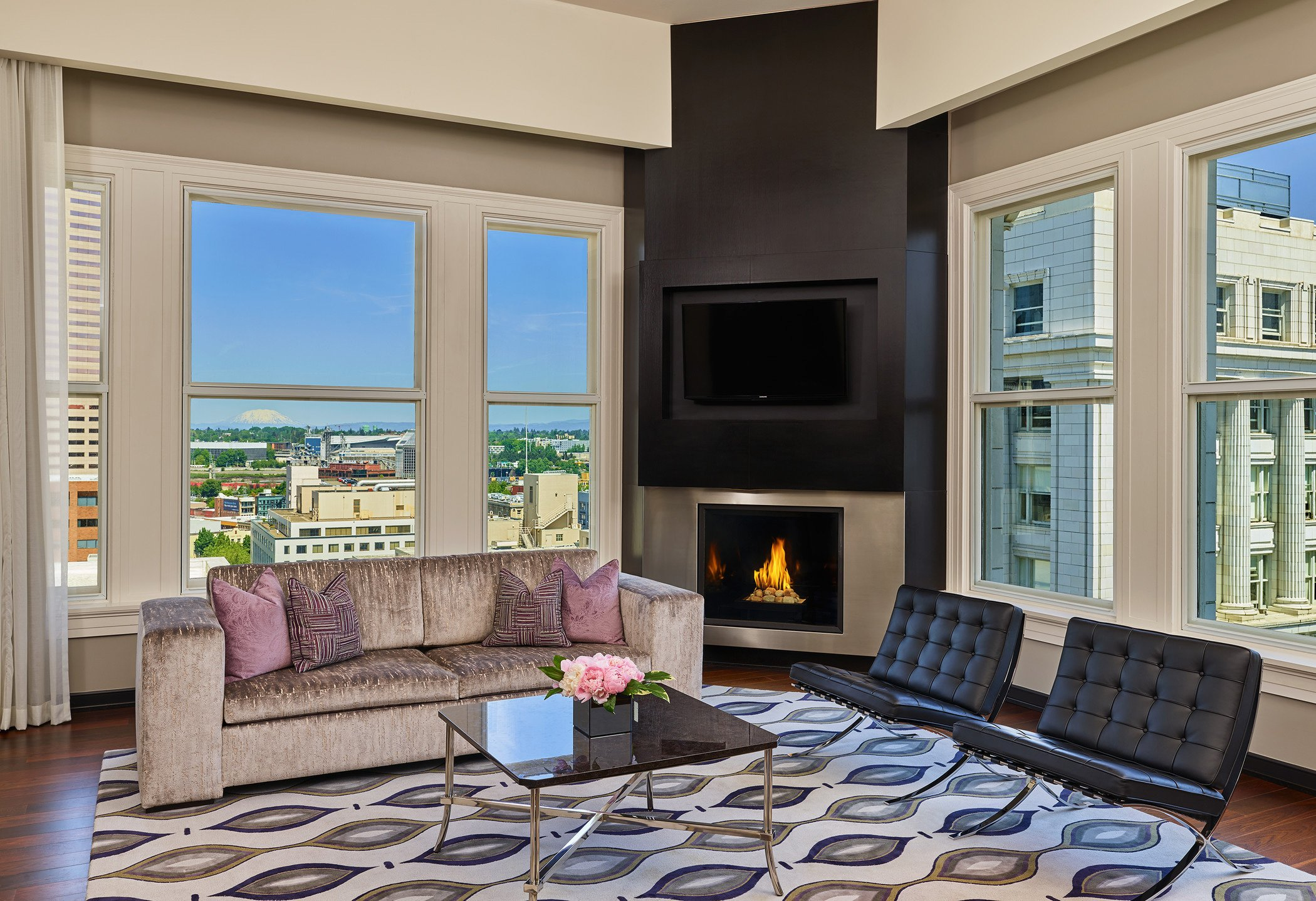 luxury hotel suite with amazing views and a corner fireplace