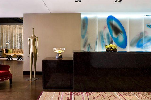 modern art fills the lobby of the nines hotel