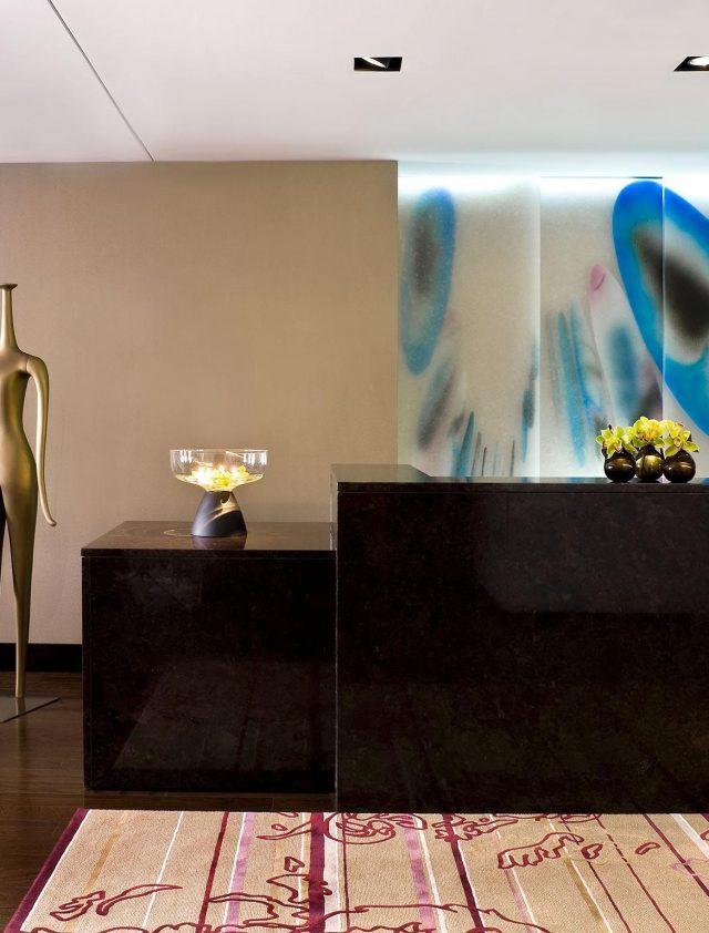 modern art fills the lobby of the nines hotel