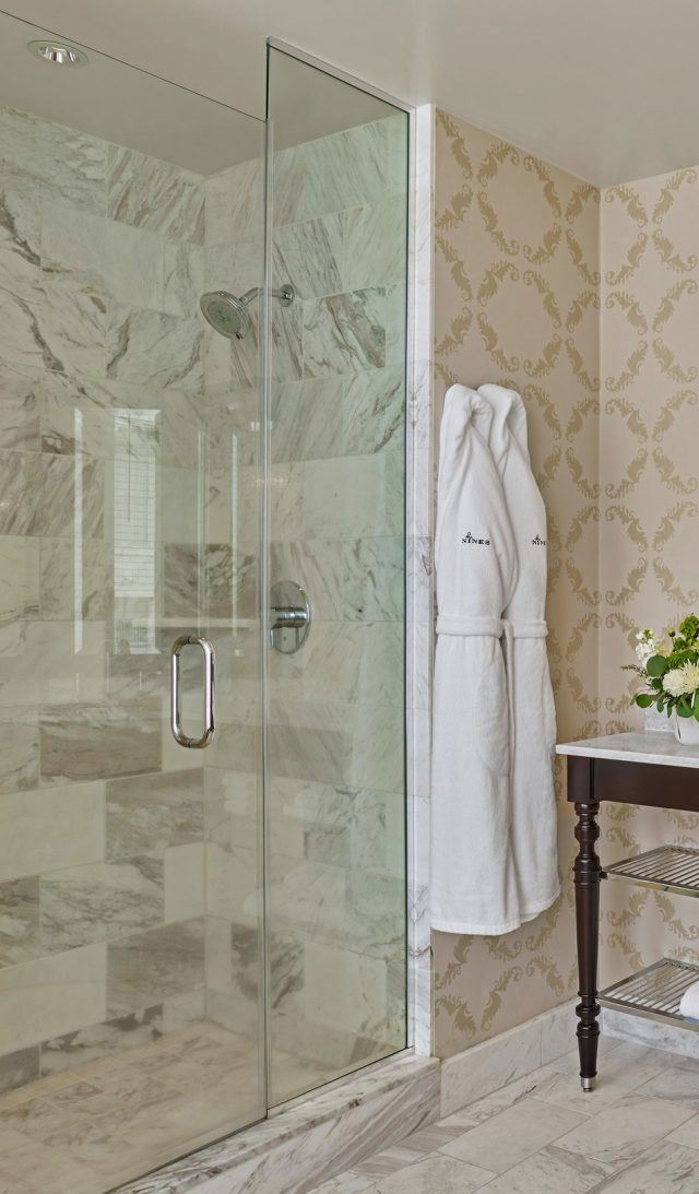stand up glass and marble shower at the nines hotel