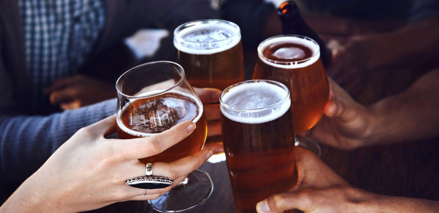 group of people cheers at the hair of the dog in portland