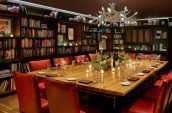 private dining space with book shelves in the background