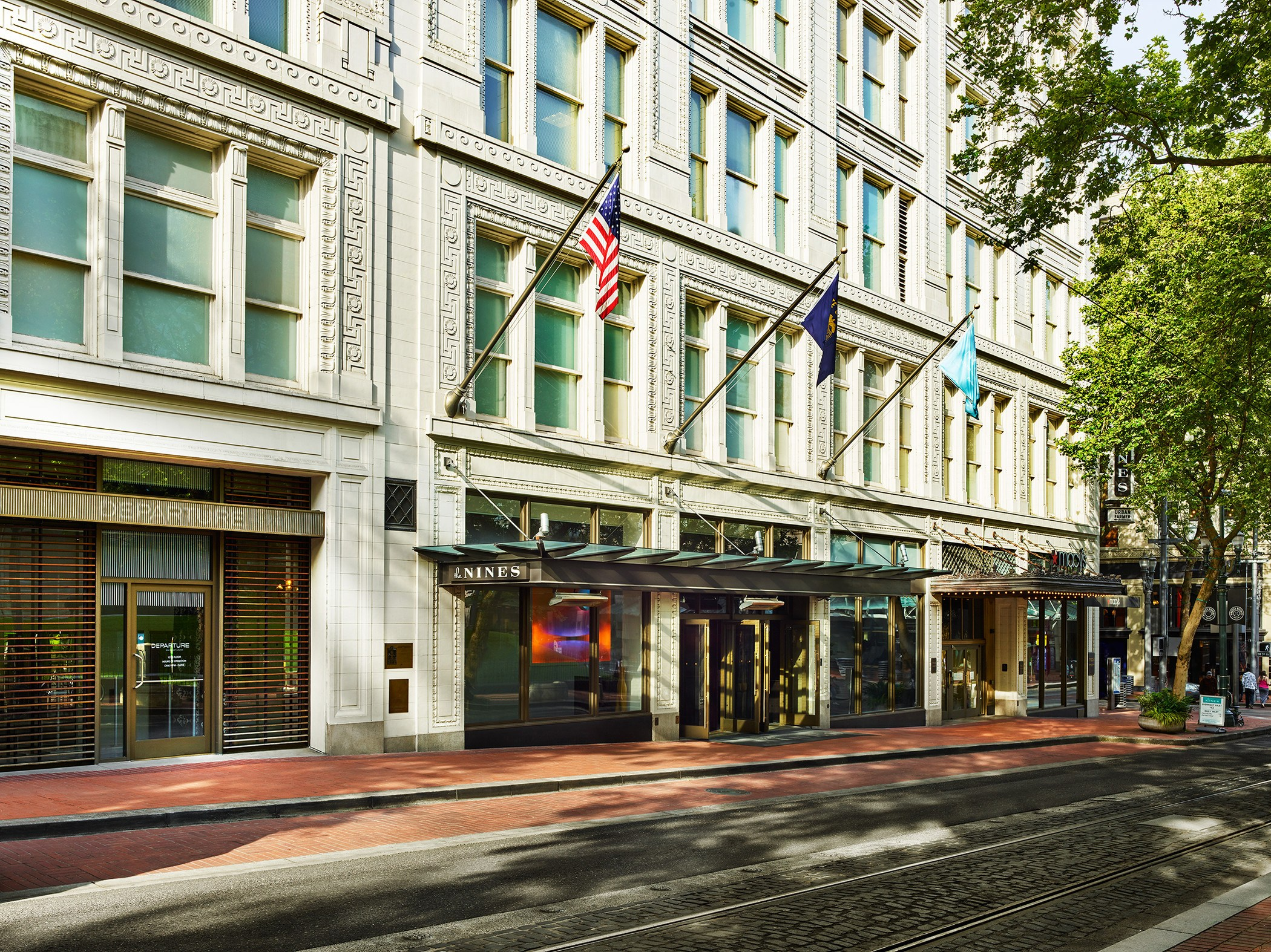 exterior facade and entrance to the nines hotel in portland