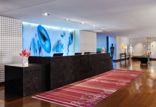 modern lobby at the nines hotel is filled with colorful artwork