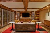 private meeting space with wine racks and large screen tv