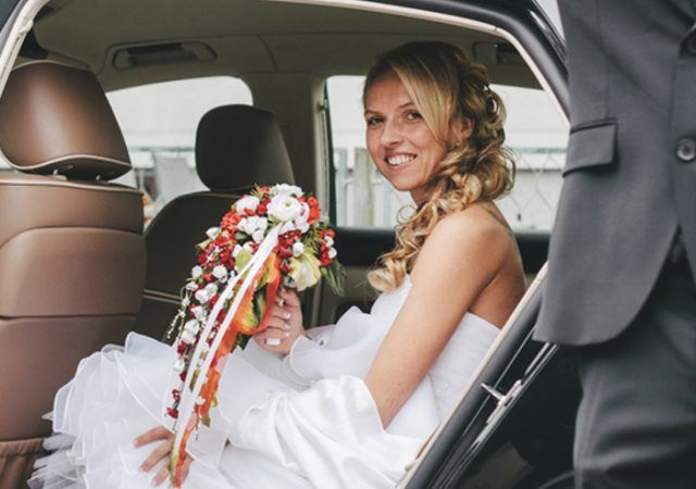 groom opened car door for his bride to get out