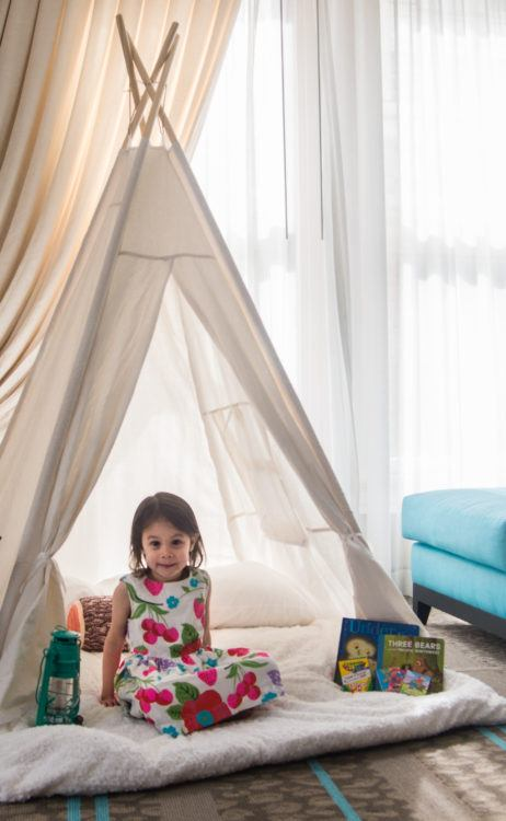 Glamping Little Girl in Tent in Hotel Room