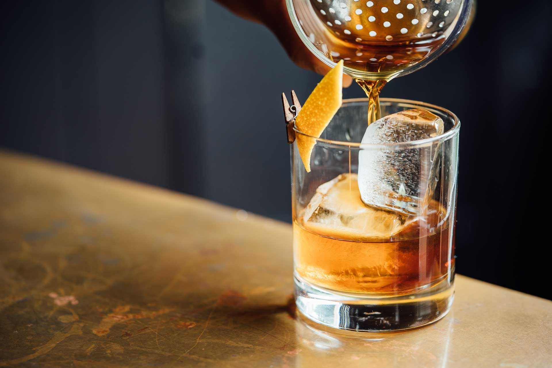 whiskey being poured into glass